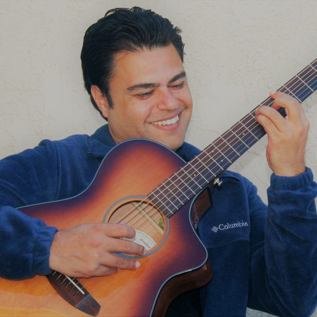 Mighty Mage Smiling with Guitar